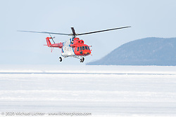 A giant Russian Mi8 helicopter (manufactured just a few hours away in Ulan-Ude) was on hand to make runs against the land based racers. Baikal Mile Ice Speed Festival. Maksimiha, Siberia, Russia. Saturday, February 29, 2020. Photography ©2020 Michael Lichter.