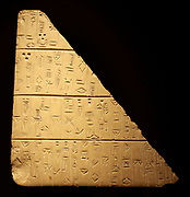 Tablet with land purchase details. Mesopotamia (Iraq) circa 2400-2200 BC. Detailing trades of land for baskets of barley by a man named Tupsikka.