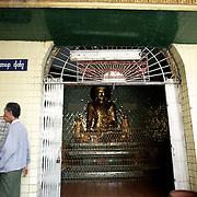 May 09, 2013 - Yangon, Myanmar: A local man passes by a shrine at Sule Pagoda in central Yangon. (Paulo Nunes dos Santos/Polaris)