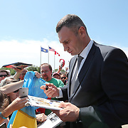 CANASTOTA, NY - JUNE 10:  2018 inductee Vitali Klitschko signs autographs prior to the 2018 induction ceremony at the International Boxing Hall of Fame for the Weekend of Champions event on June 10, 2018 in Canastota, New York. (Photo by Alex Menendez/Getty Images) *** Local Caption *** Vitali Klitschko