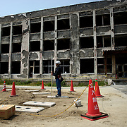 May 27, 2013 - Ishinomaki, Japan: A construction worker is seen outside Ishinomaki Okawa Elementary School, partially destroyed by  the devastating tsunami that hit the east coast of Japan in 2011. The school, which lost 70 of 108 students and nine of 13 teachers and staff, was one of the worst affected by the Tohoku earthquake. (Paulo Nunes dos Santos)
