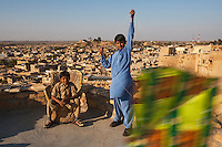 """Flying kites from the rooftop inside the old fort. Jaisalmer, Rajasthan, India<br /> Available as Fine Art Print in the following sizes:<br /> 08""""x12""""US$   100.00<br /> 10""""x15""""US$ 150.00<br /> 12""""x18""""US$ 200.00<br /> 16""""x24""""US$ 300.00<br /> 20""""x30""""US$ 500.00"""