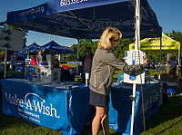 """Holly Dillon works as a volunteer at the """"check in"""" table during the Make A Wish """"Rafting for Wishes"""" event at Hesky Park on Saturday morning.  (Karen Bobotas/for the Laconia Daily Sun)"""