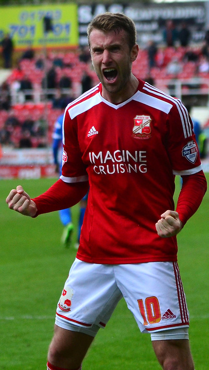 Andy Williams celebrates scoring Swindon's second goal during the Sky Bet League 1 match between Swindon Town and Leyton Orient at the County Ground, Swindon, England on 3 May 2015. Photo by Alan Franklin.