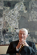Dr. John Hitt, president of the University of Central Florida, talks while sitting in front of a map of the UCF campus on the first day of classes of the fall semester in Orlando, Fla., Monday, Aug. 24, 2015. (Phelan M. Ebenhack via AP)
