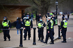 © Licensed to London News Pictures. 20/03/2021. London, UK. Police officers talk to people gathering to take part in a Rally for Freedom in central London, to protest against the continued lockdown restrictions imposed to fight the spread of coronavirus. Similar events are taking place at cities around the world. Photo credit: Ben Cawthra/LNP