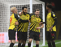 Football - 2020 / 2021 Sky Bet Championship - Watford vs Queens Park Rangers - Vicarage Road<br /> <br /> Troy Deeney of Watford celebrates scoring the opening goal from the penalty spot with Will Hughes and Tom Cleverley.<br /> <br /> COLORSPORT/ASHLEY WESTERN