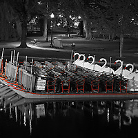 This selective color B&W New England photography image of an iconic Boston Swan Boat after sunset is available as museum quality photography prints, canvas prints, acrylic prints or metal prints. Prints may be framed and matted to the individual liking and decorating needs: <br />