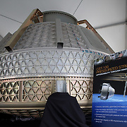 An Boeing CST-100 test capsule sits on display at the Kennedy Space Center on Friday, July 8, 2011, in Cape Canaveral, Fla. Shuttle Atlantis is scheduled to launch on Friday, July 8 and is the 135th and final space shuttle launch for NASA..  (AP Photo/Alex Menendez)