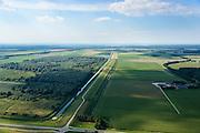Nederland, Flevoland, Gemeente Zeewolde, 27-08-2013;<br /> Knardijk richting Oostvaardersplassen met Wilgenreservaat (links van de dijk).<br /> De dijk vormt de grens tussen Oostelijk en Zuidelijk Flevoland en voorkomt dat bij een dijkdoorbraak de gehele Flevopolder overstroomt.<br /> Knardijk.The dike forms the border between Eastern and Southern Flevoland and prevents in case of breach of the outer dikes of the polder, that the entire Flevo polder will be flooded.<br /> luchtfoto (toeslag op standaard tarieven);<br /> aerial photo (additional fee required);<br /> copyright foto/photo Siebe Swart.
