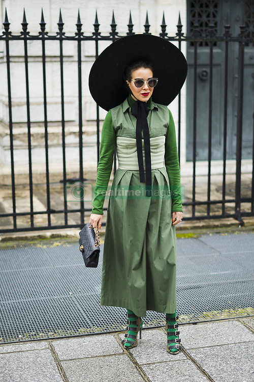 March 4, 2018 - Paris, France - A guest is seen on the street attending Valentino during Paris Women's Fashion Week A/W 2018 wearing a green outfit with large wide brime black hat and black bag on March 4, 2018 in Paris, France. (Credit Image: © Nataliya Petrova/NurPhoto via ZUMA Press)