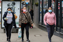 © Licensed to London News Pictures. 02/03/2021. London, UK. Women wearing a protective face coverings in north London. The number of Covid-19 infection rate and deaths have dropped more than a quarter within a week as the effect of lockdown restrictions and vaccine rollout is making an impact. Six cases of the P1 variant have been identified in people who recently returned from Brazil. Photo credit: Dinendra Haria/LNP