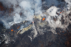 2018 05 24 - Pahoa, Hawaii, USA:  Profuse degassing occurs at fissures within the Leilani Estates subdivision, as glowing vents indicate the close presence of molten lava.<br />Photo: ZUMA/Bruce Omori/Paradise Helicopters
