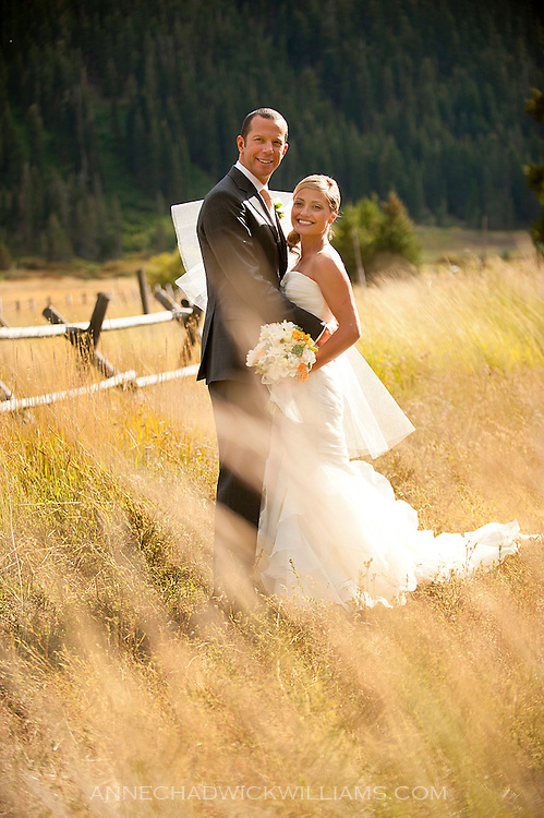 A bride and groom pose for a portrait before their wedding at Plumb Jack, Squaw Valley, Tahoe, California.
