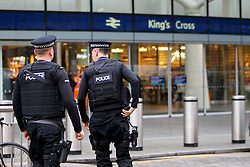 © Licensed to London News Pictures. 07/12/2015. London, UK. Armed police patrolling outside King's Cross station in London on Monday, 7 December 2015. Photo credit: Tolga Akmen/LNP