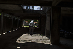 October 9, 2016 - Boa Viagem, Brazil - José is most of their time alone in the parking building Vila Florida.  José Belmiro dos Santos is 84 years old, married to Rosalia Maria da Conceição and has nine children. He is retired since 1997 and works in a parking taking care of vehicles. The parking lot is situated in an abandoned building in Boa Viagem, in Recife, Pernambuco state, Brazil.Mr. José has to live in the building and can only visit family once a month. He thinks it's dangerous, because the parking lot is located inside a slum, but need to earn cash and stay home another person can take his job.Mr. José is part of a national statistic that indicates an increase in the number of pensioners who return to work in Brazil, 5.9% in the first quarter of 2012 to 6.5% in the second quarter 2016 (data from the Brazilian Institute of geography and Statistics), due to the current economic crisis.The government of the current President Michel Temer has as one of the goals the approval of Welfare Reform, thus ensuring clearer rules for retirement and the increase in the contribution to the public coffers. The approval of new rules for retirement might take the Brazil of the crisis and increase a government approval rating scored by polemics and an impeachment questioned by the opposition. (Credit Image: © Diego Herculano/NurPhoto via ZUMA Press)