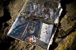 A photo album is seen in ruins of Rikuzentakata in Iwate prefecture, Japan, March 18, 2011.
