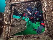 Poseidon rebreather diver inside the aircraft Cessna wreck at Dutch Springs, Scuba Diving Resort in Pennsylvania