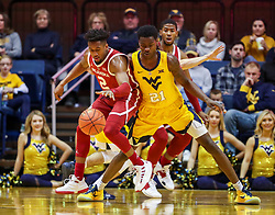 Feb 2, 2019; Morgantown, WV, USA; Oklahoma Sooners guard Aaron Calixte (2) dribbles while guarded by West Virginia Mountaineers forward Wesley Harris (21) during the second half at WVU Coliseum. Mandatory Credit: Ben Queen-USA TODAY Sports