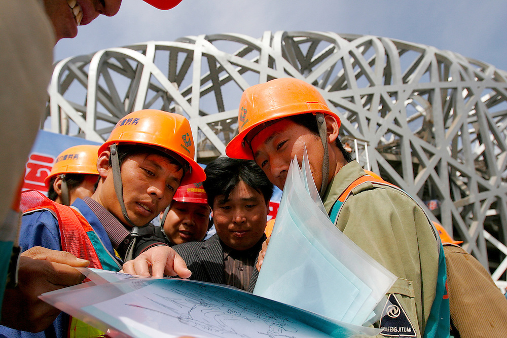 Across Beijing, China the 500 day countdown for the 2008 Olympic Games was marked on March 27, 2007. Construction workers from the Olympic Stadium were given artistic renderings by local artist Zhuming De of the stadium to celebrate.