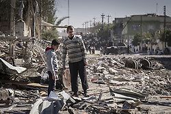 November 20, 2016 - Mosul, Nineveh Governorate, Iraq - Father and his son in front of their house at Mosul. (Credit Image: © Bertalan Feher via ZUMA Wire)