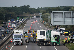 © Licensed to London News Pictures. 26/08/2017. Milton Keynes, UK. An empty road behind the scene of the M1 motorway near Milton Keynes after a crash involving a minibus and two lorries. Police say that several people are dead and four others have been taken to hospital after the accident on the southbound carriageway in the early hours of this morning. Photo credit: Ben Cawthra/LNP