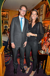the HON.FREDDIE HESKETH and LAURA HOLDSWORTH at a party for the UK launch of Mr Boho held at Annabel's, 44 Berkeley Square, London on 19th May 2016.