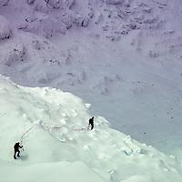 Mountaineers threading through creavsses on Baruntse Peak, Nepal