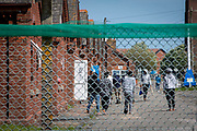 Young male asylum seekers hanging out inside Napier Barracks on the 3rd of June 2021, Folkestone, United Kingdom. Despite today's high court ruling that the Home Office's detention of Asylum seekers in Napier Barracks was unlawful, over 250 asylum seekers are still being kept in unsuitable, accommodation, they are experiencing mental health issues as well as being vulnerable to health conditions including COVID-19.  (photo by Andrew Aitchison / In pictures via Getty Images)