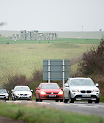 © Licensed to London News Pictures. 01/12/2014. Wiltshire, UK Traffic passes by, on the A303, The World Heritage Site of Stonehenge in Wiltshire today 1st December 2014. A tunnel passing Stonehenge is among dozens of new road schemes announced by the government, as part of £15bn of improvements to England's roads. Photo credit : Stephen Simpson/LNP