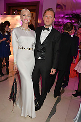 AMANDA CRONIN and PETER ZAAR at the QBF Spring Gala in aid of the Red Cross War Memorial Children's Hospital hosted by Heather Kerzner and Jeanette Calliva at Claridge's, Brook Street, London on 12th May 2015.
