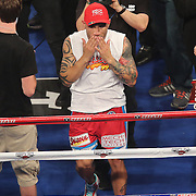 Miguel Cotto of Puerto Rico kisses to the crowd after defeating Delvin Rodriguez of the Dominican Rebublic  in a 12-round super welterweight bout at the Amway Center in Orlando, Florida on Saturday, October 5, 2013. Cotto won by knockout in the 3rd round of the match.(Photo/Alex Menendez)