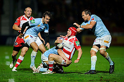 Gloucester Full Back (#15) Rob Cook is tackled during the second half of the match - Photo mandatory by-line: Rogan Thomson/JMP - Tel: 07966 386802 - 12/10/2013 - SPORT - RUGBY UNION - Kingsholm Stadium, Gloucester - Gloucester Rugby v USA Perpignan - Heineken Cup Round 1.