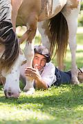 Gaucho lies beneath his horse, Estancia La Bamba De Areco, Pampas, Argentina, South America