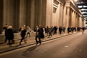 Rush-hour commuters blurr as they walk down Threadneedle Street and past the Bank of England in the Square Mile, the heart of the capital's historical financial district, on 2nd October 2017, in the City of London, England.