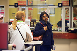 © Licensed to London News Pictures. 30/09/2013<br /> This customer looking stressed with the Queue at <br /> Orpington Post Office in Orpington High Street,Greater London.<br /> Post Office Strikes Today (30.09.2013)<br /> Long delays and queuing for customers today at Branches of the Post Office across the UK  due to industrial action being taken by the Communication Workers Union.<br /> Photo credit :Grant Falvey/LNP