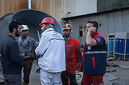 Miners and rescue workers take a break at the site of the ongoing rescue effort to find an estimated 100 miners still trapped underground. An explosion caused by an electrical fault in Somas' coal mine resulted in at least 282 deaths. Rescue efforts continue into the third evening. Soma, western Turkey.