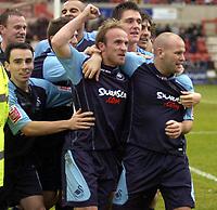 Photo: Matt Bright/Sportsbeat Images.<br /> Swindon Town v Swansea City. Coca Cola League 1. 01/01/2008.<br /> Thomas Butler (c) celebrates scoring for Swansea