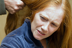 Man pulling woman's hair,