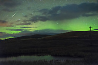 Early in the morning the northern horizon glowed green. This was caused by a geomagnetic storm from a recurring coronal hole on the sun. A coronal hole is an opening in the outer atmosphere of the sun that allows the high-speed solar wind to escape, which triggers the aurora when it impacts Earth's magnetic field. Since the sun rotates on it's axis every 27 days, this can be predicted in advance. I saw the aurora from this coronal hole in September, but last month it was too cloudy. I was determined to see it again this weekend even if it meant staying up all night dodging clouds (aurora hunting is an addiction). The infrared satellite showed a gap in the clouds moving in at 2AM, so I made some coffee and found a dark spot on the Wyoming/Montana state line to watch and wait. It wasn't the best display I've seen, but I'll take what I can get during solar minimum, and the meteor was a nice bonus.