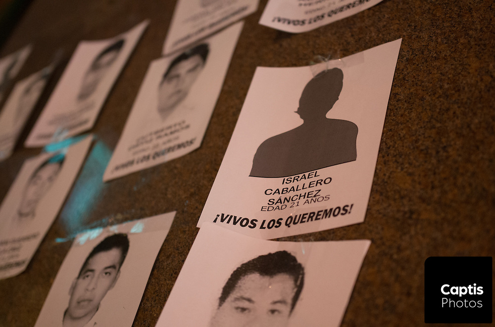 Photos of some of the missing students hang on a wall at the Human Rights Memorial. November 20, 2014.