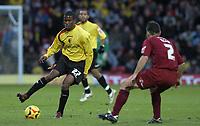 Photo: Alan Crowhurst.<br />Watford v Brighton & Hove Albion. Coca Cola Championship. 03/12/2005. <br />Watford's Joel Grant (L) takes on Paul Reid.