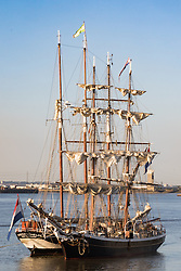 Woolwich, London, September 14th 2016. The afternoon sun illuminates the sfurled sails and masts of  tall ships gathered for the Sail Greenwich Festival 2016 on the River Thames at Woolwich.  ©Paul Davey<br /> FOR LICENCING CONTACT: Paul Davey +44 (0) 7966 016 296 paul@pauldaveycreative.co.uk
