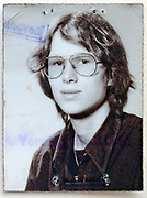 identity and passport style head and shoulder portrait of young adult man looking at the camera