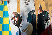 On the day that UK Prime Minster, Boris Johnson announced in parliament of a major easing of Coronavirus pandemic restrictions on July 4th next week - including the re-opening of pubs, restaurants, hotels and hairdressers in England - a detail of a billboard shows peeling imagery of black men, near the Southbank which remains closed for the forseeable future, on 23rd June 2020, in London, England. The three month two metre social distance will be also reduced to one metre plus but in the last 24hrs, a further 171 have died from Covid, bringing the UK total to 42,927.