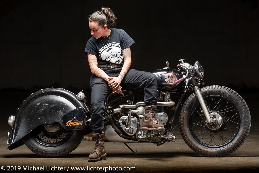 Madhouse Motors J Shia with her 1957 custom Royal Enfield Indian (Royal Enfield imported and rebadged as Indians after the Springfield factory was closed in 1953) bobber built out of J's Boston shop. The Handbuilt Show. Austin, Texas USA. Friday, April 12, 2019. Photography ©2019 Michael Lichter.