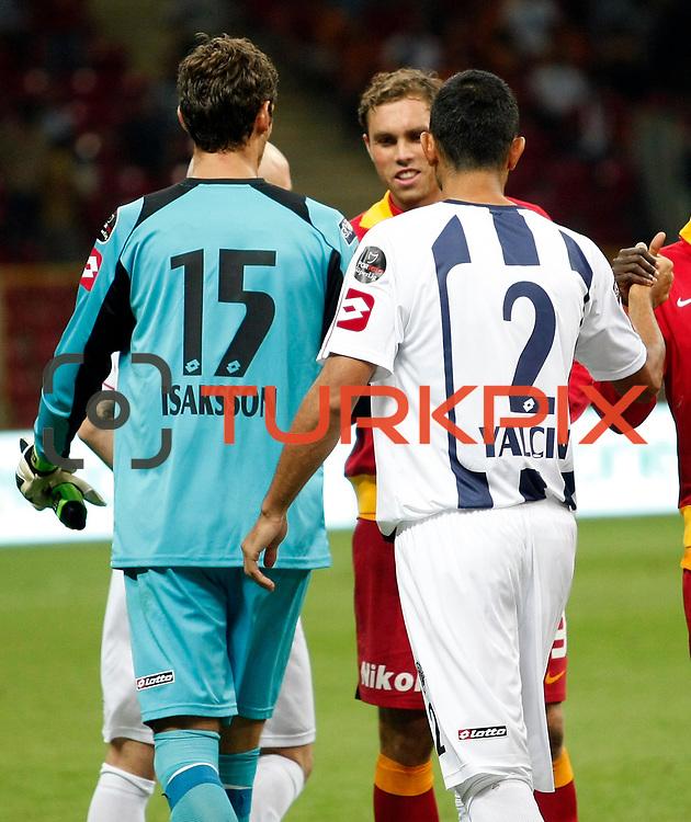 Galatasaray's Johan Elmander (Back R) and Kasimpasa's goalkeeper Andreas Isaksson during their Turkish Super League soccer match Galatasaray between Kasimpasa at the TT Arena at Seyrantepe in Istanbul Turkey on Monday 20 August 2012. Photo by TURKPIX