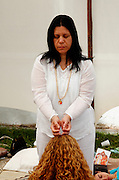 Giving a Deeksha. Deeksah or diksha from Sanskrit meaning initiation an energy transfer, planting the seed of Oneness