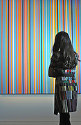 © Licensed to London News Pictures. 11/11/2011. London, UK. A woman looks at Bridget Riley's Praise 1, estimated to fetch 150,000 - 250,000 GBP. Sotheby's preview of Modern and Post-War British Art which will offered for sale at auction on 15th November 2011. Photo credit : Stephen Simpson/LNP