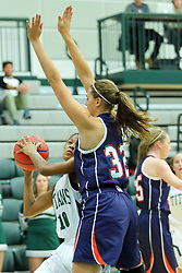 06 December 2017:  Raven Hughes defended by Jill Berg during an NCAA women's basketball game between the Wheaton Thunder and the Illinois Wesleyan Titans in Shirk Center, Bloomington IL